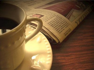 sunday paper & coffee cup